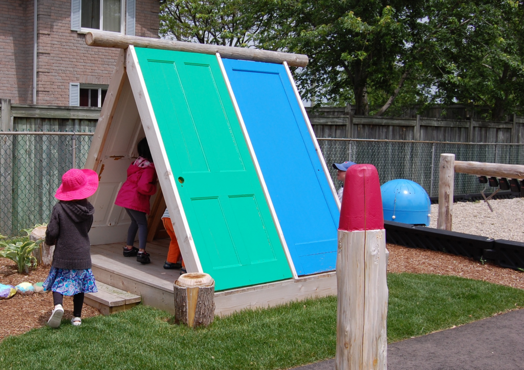 Playhouse made from recycled doors earthscape toronto for Diy play structure