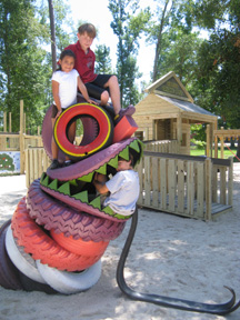 Entyrely fun playgrounds james jolley playscapes for Tire play structure