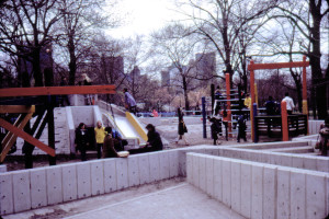 View of the playground in 1979. In addition to concrete structures, the playground included tire swings and wood climbing structures.